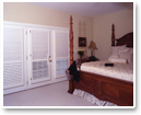 Plantation shutters can also be used to cover doors. Divider rails let you choose how to direct the light entering through the upper and lower sections.