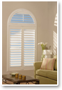 Shutters can even be used to elegantly cover specialty windows, like this arch.