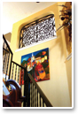 Faux Iron Art provides a beautiful complement to the art in this stairwell.