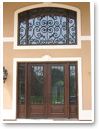 Faux Iron Art is custom-made for each application solving the question about covering arches, sidelights and windows on doors.