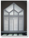 Vinyl Shutters are right at home in uniquely shaped windows.