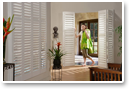 Create a cohesive look throughout your home by using shutters creatively on windows and as interior doors.