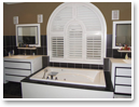 Vinyl Shutters work beautifully in tough environments like humid bathrooms and arched windows.