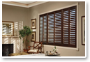 Chose plantation shutters with wide louvers to open up your view.