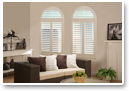 Choose calming white shutters to make a room appear larger and more airy.