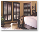 Handsome real wood shutters add elegance to décor and complement the furniture in the room for a professional decorator's touch.